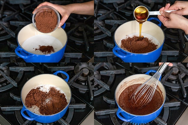 A blue sauce pan is filled with the ingredients to make paleo chocolate pudding: coconut milk, cocoa powder, honey, salt, and vanilla.