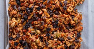 An overhead shot of a tray of chocolate cherry paleo granola, a tasty homemade holiday edible gift
