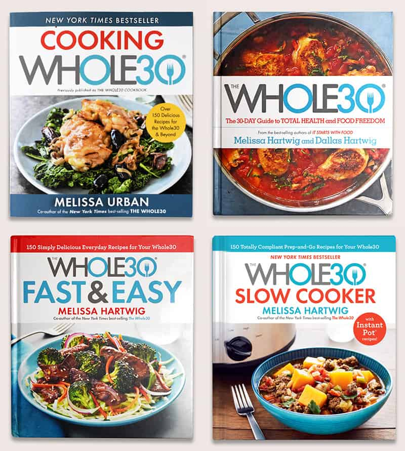 An overhead shot of 4 Whole30 cookbooks.