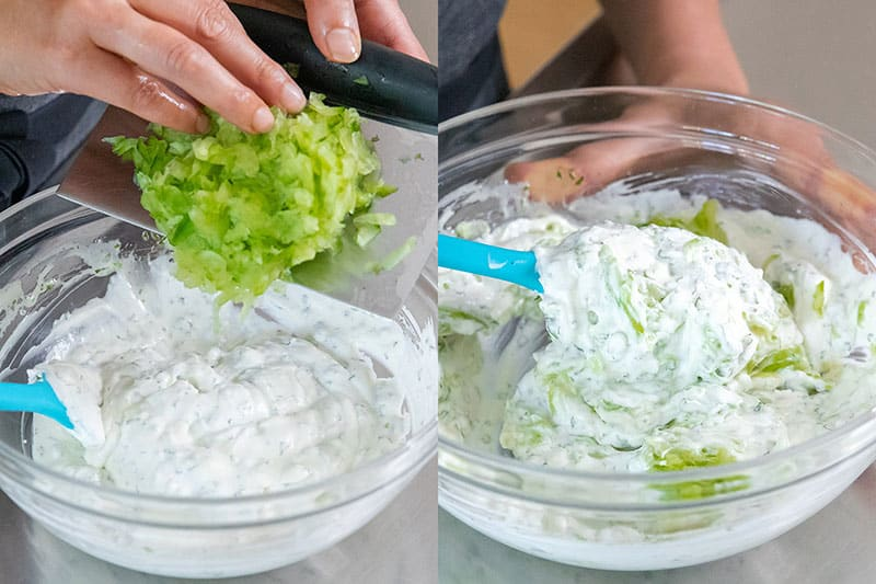 Adding the drained and diced cucumbers to the vegan tzatziki base.