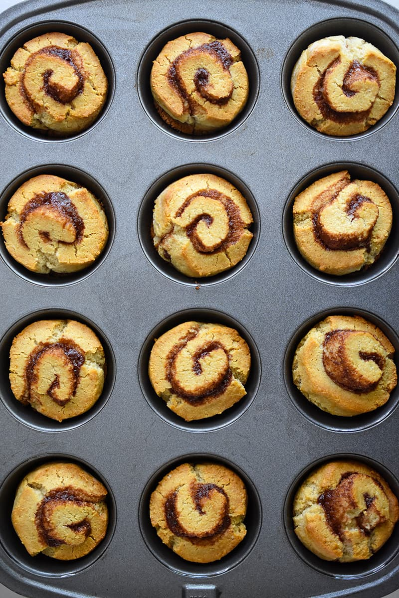 An overhead shot of the finished paleo cinnamon rolls baked in a muffin tin.