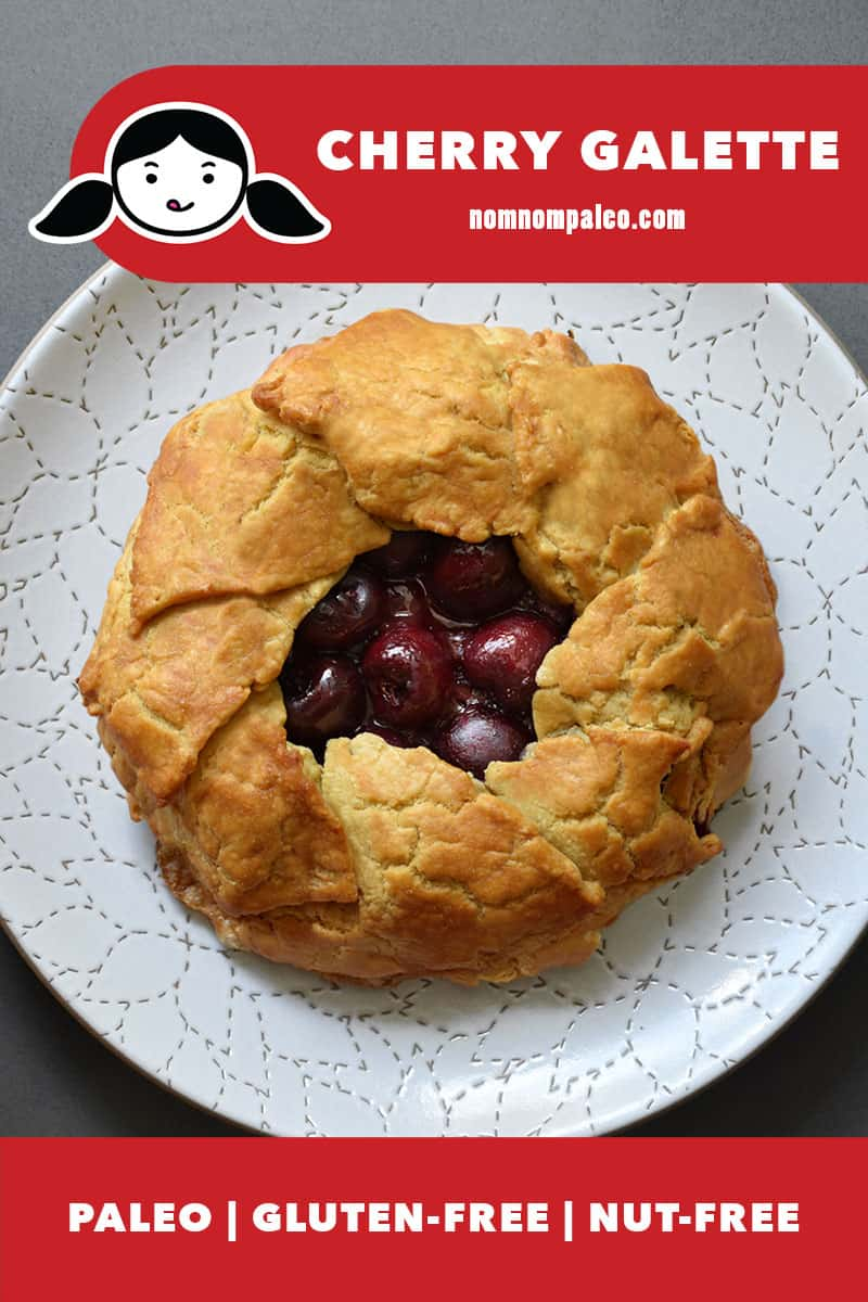 An overhead shot of a paleo cherry galette on top of a white plate. There is a red banner at the bottom that states that it is paleo, gluten-free, and nut-free.