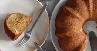 An overhead shot of paleo and gluten free apple Bundt Cake surrounded by three plates with cake slices