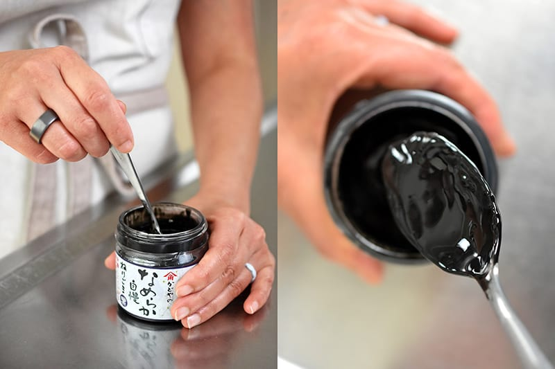 Someone stirring a jar of Japanese black sesame paste and an overhead shot of someone spooning it out. It looks glossy black and runny.