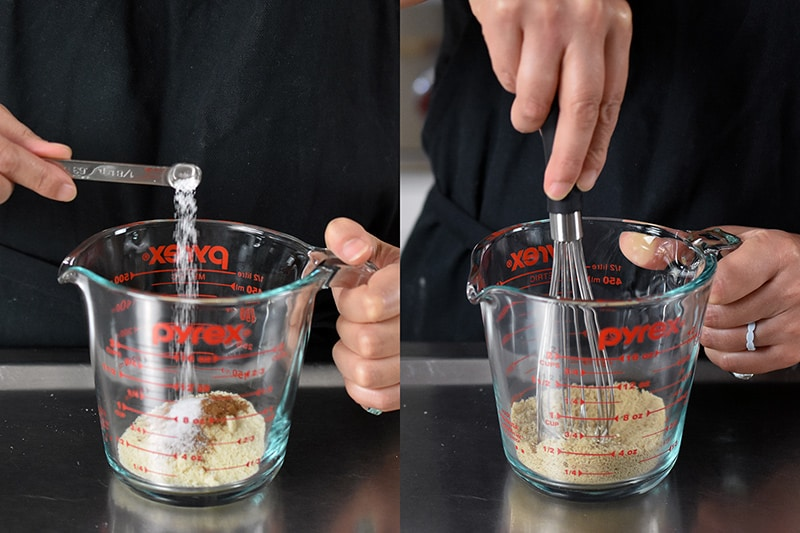 Adding the dry ingredients for pumpkin mug cake to a liquid measuring cup and whisking it together.