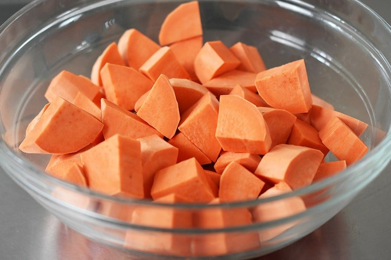 A bowl of sweet potatoes cut into cubes