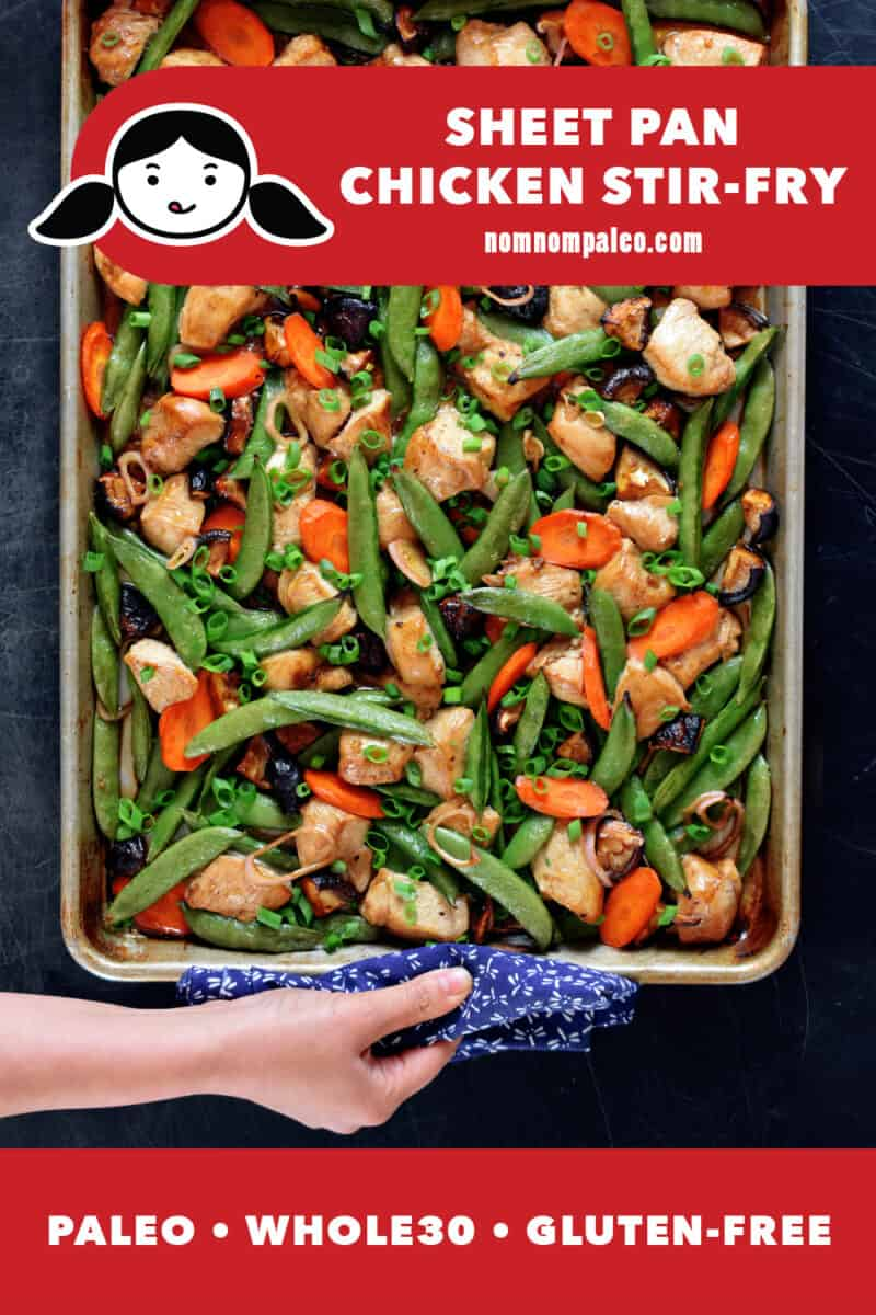 An overhead shot of sheet pan chicken stir-fry fresh out of the oven. A hand is holding the edge of the pan with a towel. The red banner at the bottom reads paleo, Whole30, gluten-free.