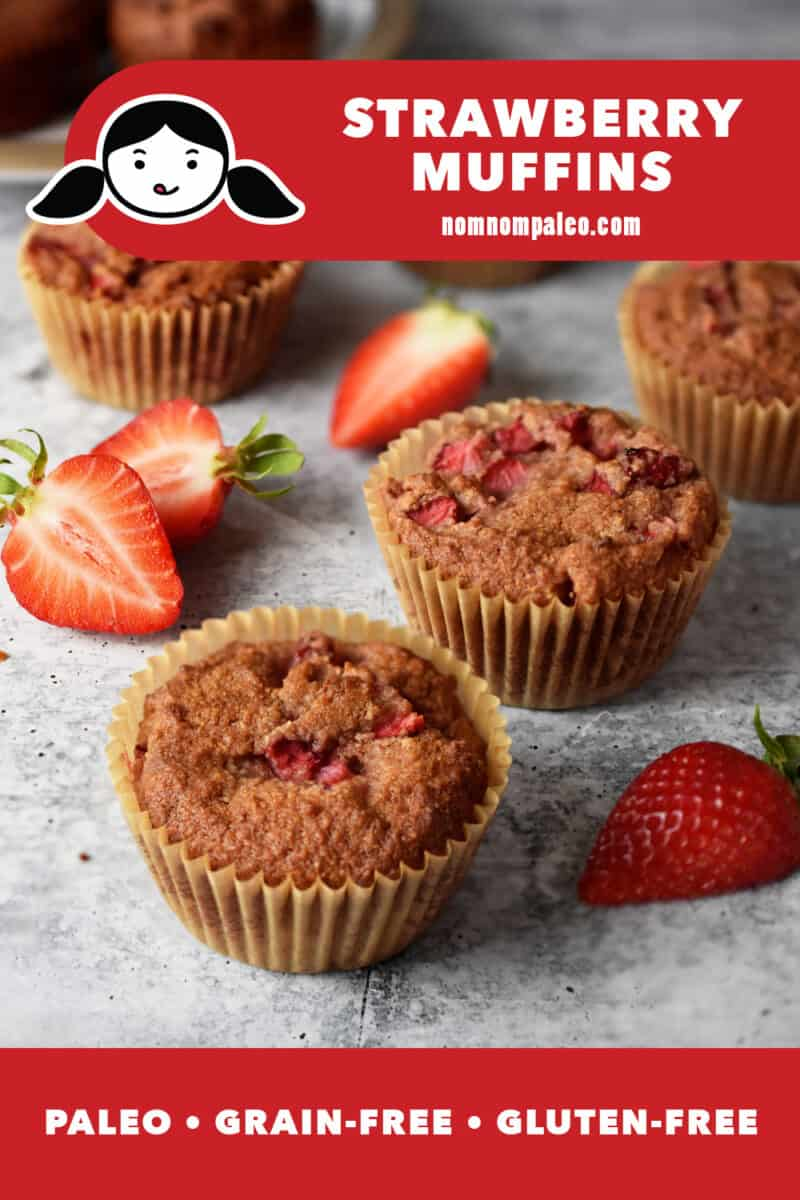 Strawberry muffins on a marble countertop next to sliced strawberries. A red banner at the bottom says paleo, grain-free, and gluten-free.