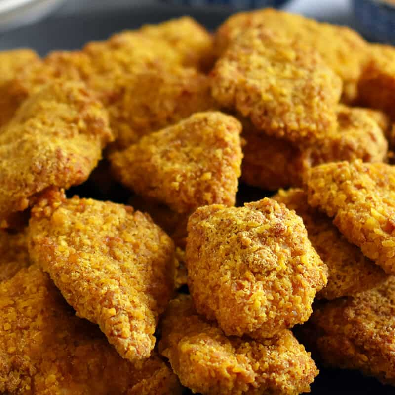 A closeup of a plate topped with air fryer chicken nuggets, a paleo, nut-free, gluten-free, and grain-free favorite.